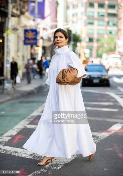 Victoria Barbara is seen wearing white dress The Row shoes and clutch Bottega Veneta during New York Fashion Week September 2019 on September 09 2019...