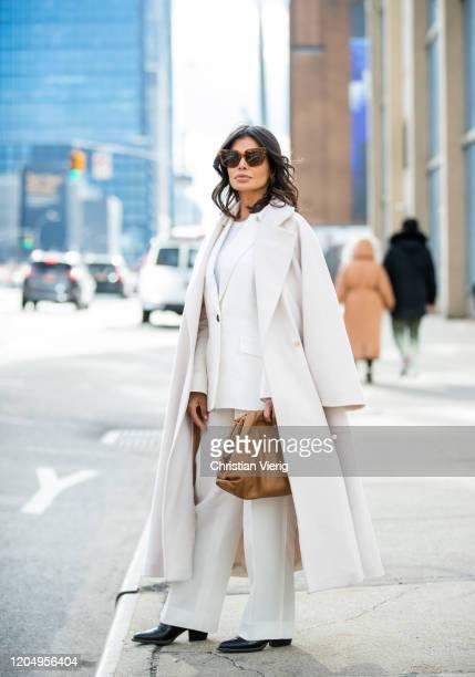 Victoria Barbara is seen wearing white Jil Sander suit Max Mara white coat brown Bottega Veneta pouch bag Bottega Veneta shoes Celine sunglasses...