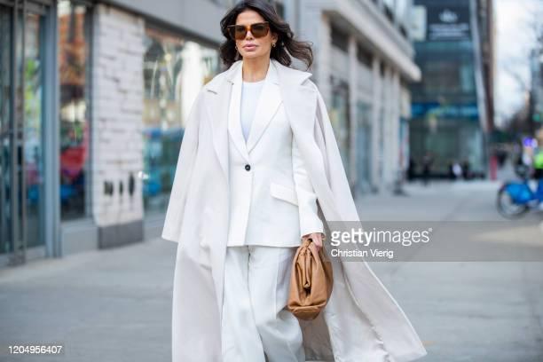 Victoria Barbara is seen wearing white Jil Sander suit Max Mara white coat brown Bottega Veneta pouch bag Celine sunglasses during New York Fashion...