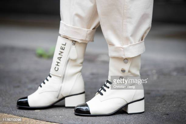 Victoria Barbara is seen wearing white laced Chanel boots during Milan Fashion Week Spring/Summer 2020 on September 22, 2019 in Milan, Italy.