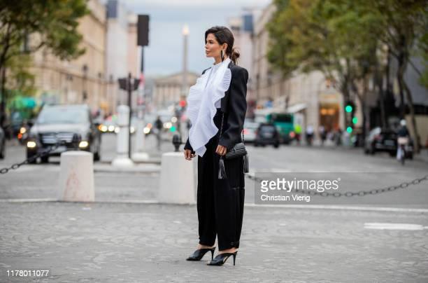 Victoria Barbara seen wearing Givenchy two tone black white blazer black pants bag and heels during Paris Fashion Week Womenswear Spring Summer 2020...