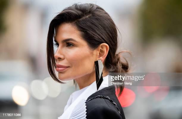 Victoria Barbara seen wearing Givenchy two tone black white blazer black pants earrings during Paris Fashion Week Womenswear Spring Summer 2020 on...