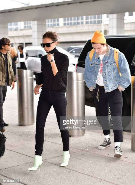 Victoria Beckham and Brooklyn Beckham arrive to JFK International Airport for a departing flight on October 13 2017 in New York City