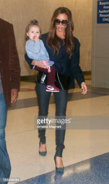 Victoria Beckham and daughter Harper Seven arrive at JFK airport on October 19 2012 in New York City