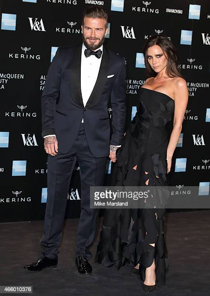 Victoria Beckham and David Beckham attend a private view for the 'Alexander McQueen Savage Beauty' exhibition at Victoria Albert Museum on March 12...