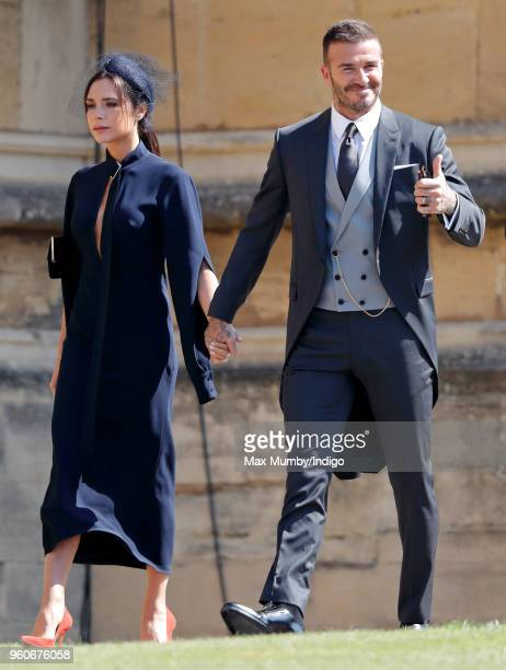 Victoria Beckham and David Beckham attend the wedding of Prince Harry to Ms Meghan Markle at St George's Chapel Windsor Castle on May 19 2018 in...