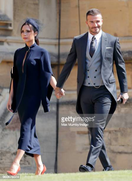 Victoria Beckham and David Beckham attend the wedding of Prince Harry to Ms Meghan Markle at St George's Chapel, Windsor Castle on May 19, 2018 in...