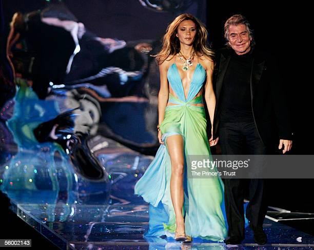 Victoria Beckham and designer Roberto Cavalli arrive on stage at the Swarovski Fashion Rocks for The Prince's Trust event at the Grimaldi Forum...