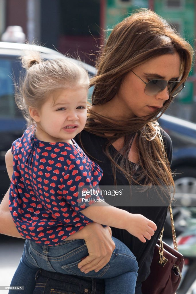 Victoria Beckham and her daughter Harper Seven are seen arriving at the 'BONTON' store on May 4, 2013 in Paris, France.