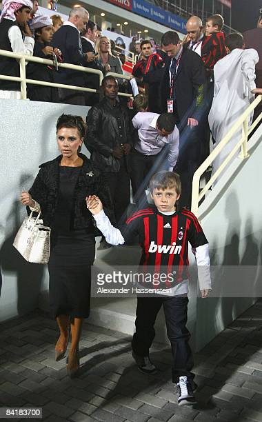 Victoria Beckham and her son Brooklyn are seen during the Dubai Football Challenge match between AC Milan and Hamburger SV at the Emirates Sevens...