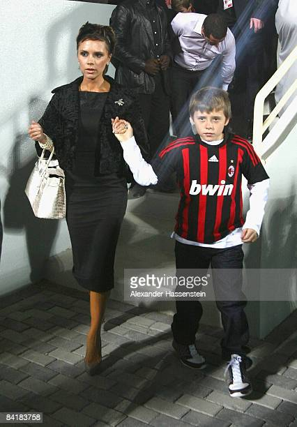 Victoria Beckham and her son Brooklyn seen during the Dubai Football Challenge match between AC Milan and Hamburger SV at the Emirates Sevens Stadium...