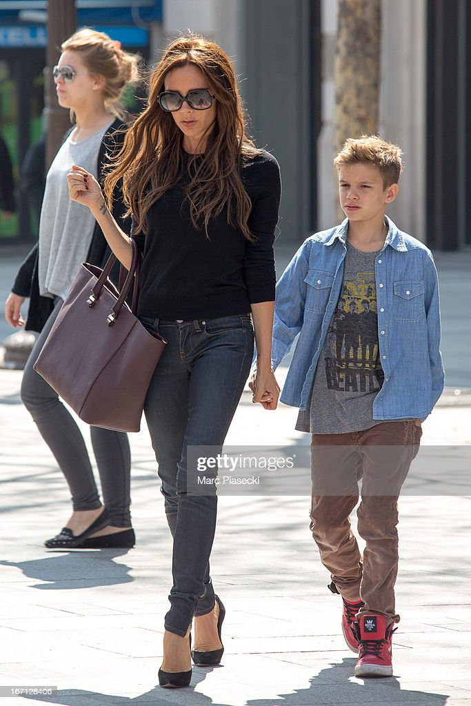 Victoria Beckham and her son Romeo James are seen leaving the 'NIKE' store on the Champs-Elysees Avenue on April 21, 2013 in Paris, France.