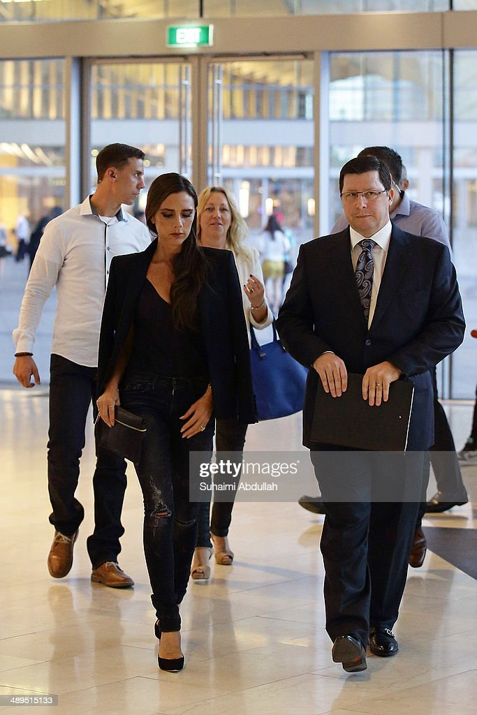 Victoria Beckham and John Postle, Vice President of Retail for the Marina Bay Sands, are seen in The Shoppes at the Marina Bay Sands on May 11, 2014 in Singapore. Victoria Beckham is in Singapore for the first time to showcase her ready-to-wear pieces from her eponymous fashion label in Singapore