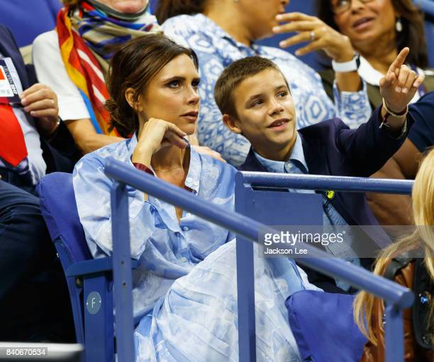 Victoria Beckham and Romeo Beckham watch Federer vs Tiafoe at Arthur Ashe Stadium on August 29 2017 in New York City