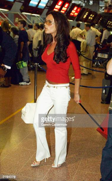 Victoria Beckham arrives at Heathrow Airport July 24 2003 in London on her way to New York
