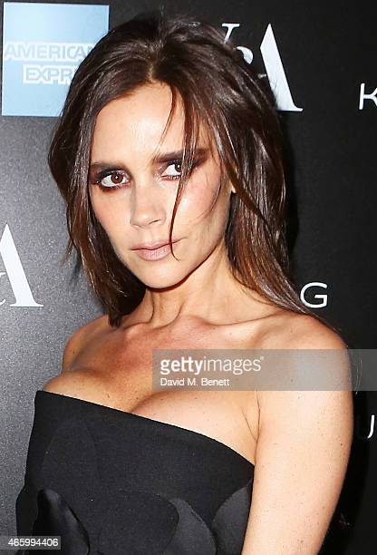 Victoria Beckham arrives at the Alexander McQueen: Savage Beauty Fashion Gala at the V&A, presented by American Express and Kering on March 12, 2015...