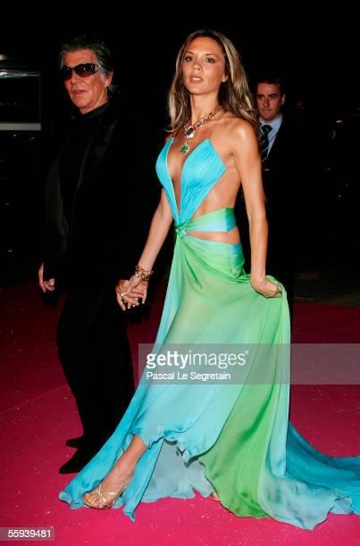 Victoria Beckham arrives with Designer Roberto Cavalli at the Swarovski Fashion Rocks for The Prince's Trust event at the Grimaldi Forum October 17...
