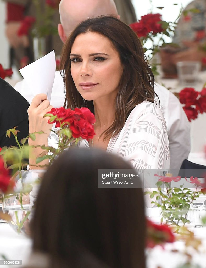 Victoria Beckham attends the Kent & Curwen show during London Fashion Week Men's June 2018 on June 10, 2018 in London, England.