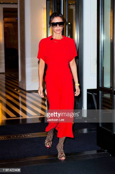 Victoria Beckham comes out of her hotel wearing a red dress on October 16, 2019 in New York City.
