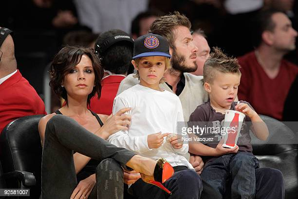 Victoria Beckham Cruz Beckham David Beckham and Romeo Beckham attend the Los Angeles Lakers v Dallas Mavericks game on October 30 2009 in Los Angeles...