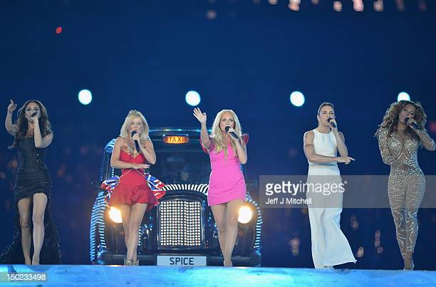Victoria Beckham, Geri Halliwell, Emma Bunton, Melanie Chisholm and Melanie Brown of The Spice Girls perform during the Closing Ceremony on Day 16 of...