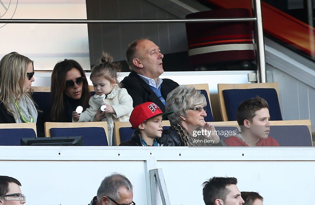 Victoria Beckham, holding her daughter Harper Beckham, Ted Beckham, David's father, below Romeo Beckham, Sandra Beckham, David's mother and Brooklyn Beckham watch the french Ligue 1 match between Paris Saint-Germain FC and AS Nancy-Lorraine ASNL at the Parc des Princes stadium on March 9, 2013 in Paris, France.