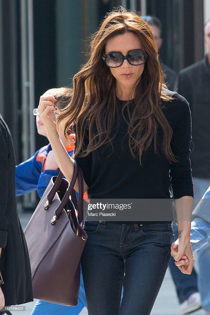 Victoria Beckham is seen leaving the 'NIKE' store on the Champs-Elysees Avenue on April 21, 2013 in Paris, France.
