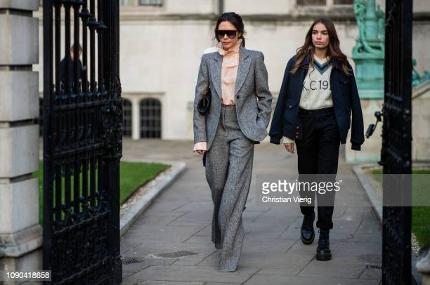 Victoria Beckham is seen outside Kent Curwen wearing grey suit with flared pants salmon colored ruffled blouse Hana Cross during London Fan Week...