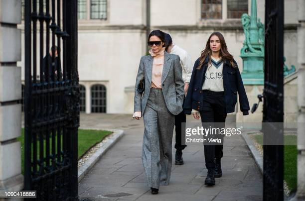 Victoria Beckham is seen outside Kent Curwen wearing grey suit with flared pants salmon colored ruffled blouse Hana Cross Brooklyn Beckham during...