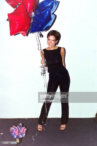 Victoria Beckham of The Spice Girls celebrate as their single Viva Forever goes to number one in the charts, their seventh number one record, London,...