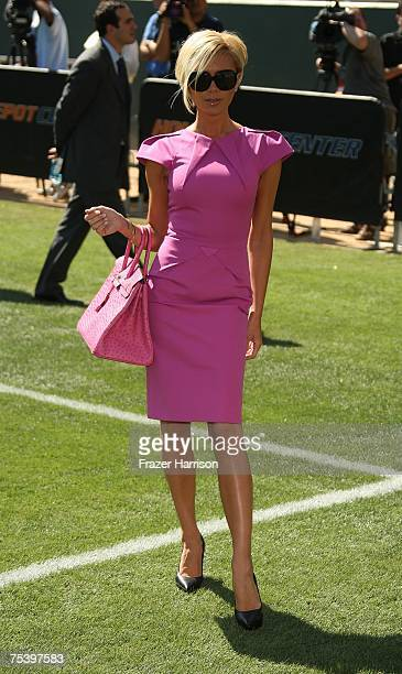 78f1f3c94a5 Victoria Beckham poses at the Home Depot Center Stadium where her husband  David Beckham was officially