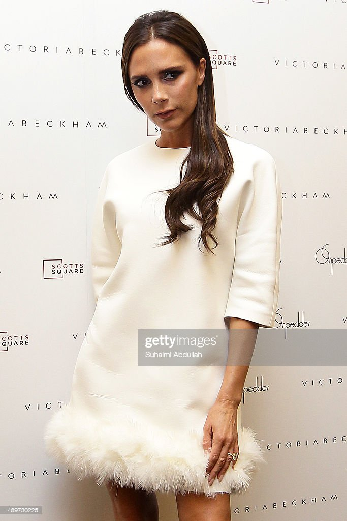 Victoria Beckham poses for a photo at On Pedder at Scotts Square on May 12, 2014 in Singapore. Victoria Beckham is in Singapore for the first time to showcase her ready-to-wear pieces from her eponymous fashion label in Singapore
