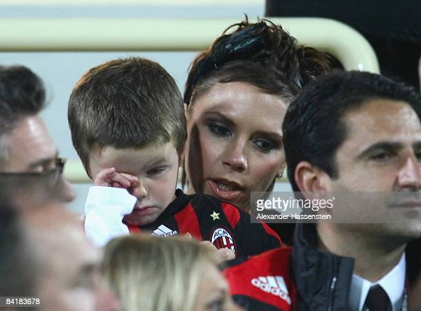 Victoria Beckham talks to her son Cruz during the Dubai Football Challenge match between AC Milan and Hamburger SV at the Emirates Sevens Stadium on...