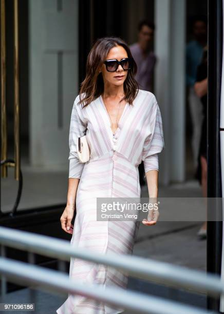 Victoria Beckham wearing white dress is seen outside Kent Curwen during London Fashion Week Men's June 2018 on June 10 2018 in London England