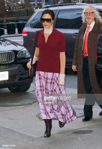 Victoria Beckham wears a maroon top with a tartan pattern skirt on March 3 2018 in New York City