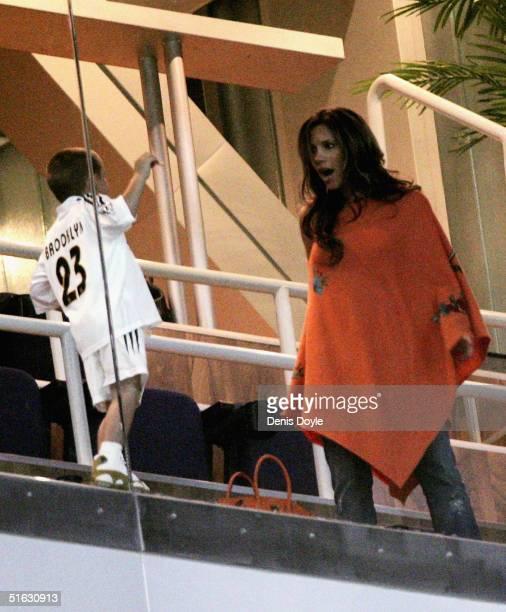 Victoria Beckham wife of David Beckham talks to their son Brooklyn before the La Liga match between Real Madrid and Getafe at the Santaigo Bernabeu...