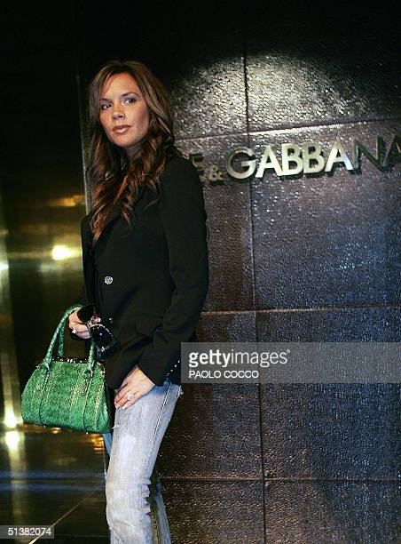 Victoria Beckham wife of English football star David Beckham poses before the Dolce Gabbana Spring/Summer 2005 women's collection at Milan fashion...