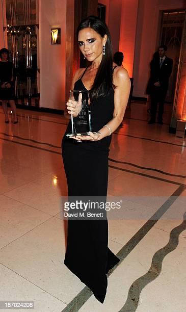 Victoria Beckham, winner of the Special Contribution to British Fashion award, attends the Harper's Bazaar Women of the Year awards at Claridge's...