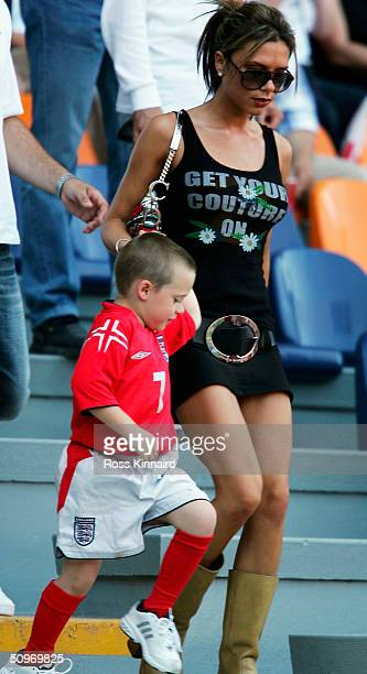 Victoria Beckham with her son Brooklyn during the UEFA Euro 2004, Group B match between England and Switzerland at the Estadio Cidade de Coimbra on...
