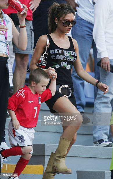 Victoria Beckham with her son Brooklyn during the UEFA Euro 2004 Group B match between England and Switzerland at the Estadio Cidade de Coimbra on...