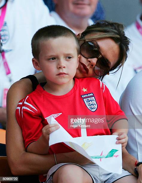 Victoria Beckham with her son Brooklyn prior to the UEFA Euro 2004, Group B match between England and Switzerland at the Estadio Cidade de Coimbra on...