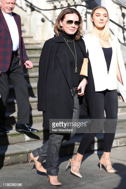 Victoria Beckham's sister Louise Adams attends the Victoria Beckham Show at Tate Britain during LFW February 2019 on February 17 2019 in London...