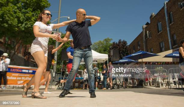 Victoria Bilyk and Ciro Viviano both of Nudiczo Dance Studio show off their moves on St Clair Avenue part of Salsa on St Clair festival Summer fun in...