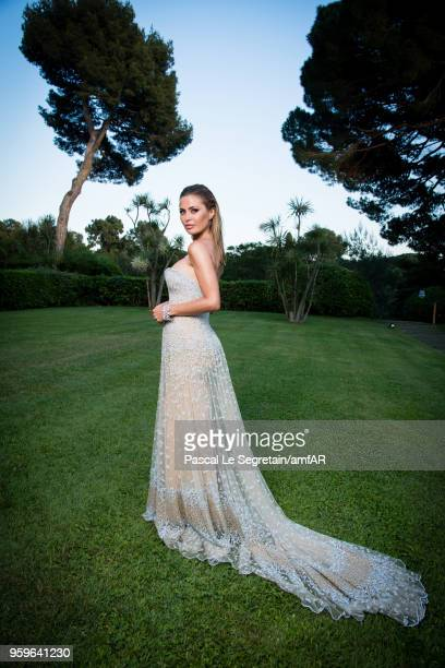 Victoria Bonya poses for portraits at the amfAR Gala Cannes 2018 cocktail at Hotel du CapEdenRoc on May 17 2018 in Cap d'Antibes France