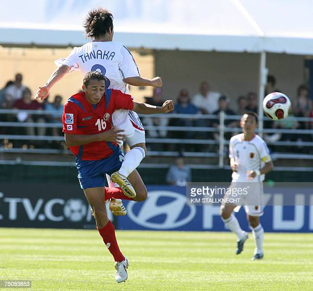 Atomu Tanaka of Japan collides with Leslie Ramos of Costa Rica in first half action during the FIFA U20 in Victoria Canada 04 July 2007 AFP PHOTO/Kim...