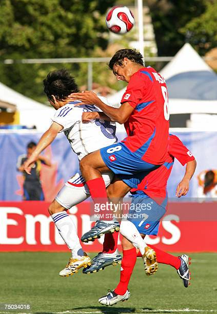 Celso Borges of Costa Rica and Atomu Tanaka of Japan vie for the ball during their U20 World Cup football match in Victoria British Columbia Canada...