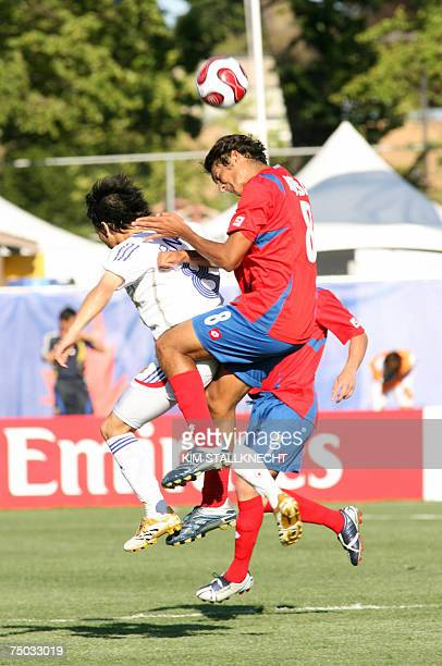 Celso Borges of Costa Rica heads the ball against Atomu Tanaka of Japan during second half action in Victoria Canada 04 July 2007 Japan won 10 AFP...