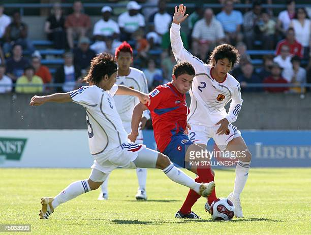 Costa Rica's Pablo Herrera is blocked by Japan's defender Atsuto Uchida and midfielder Tanaka Atomu during their U20 World Cup football match in...