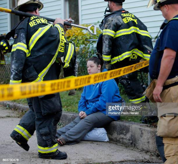 Victoria Cann waits to speak with Red Cross volunteers as firefighters pack up their gear following a fire on Island Avenue in Sanford on Thursday...