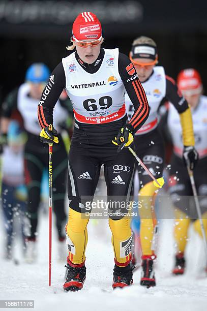 Victoria Carl of Germany competes in the Women's 9km Classic Pursuit at the FIS Cross Country World Cup event at DKB Ski Arena on December 30 2012 in...